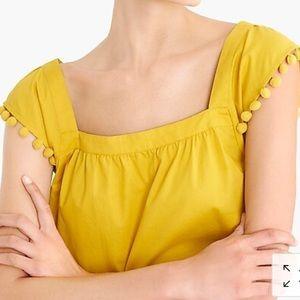 Square-neck top in cotton poplin with pom-poms